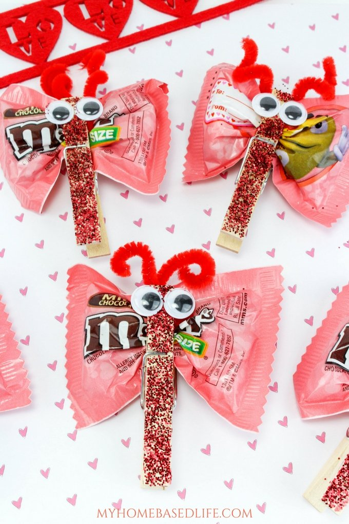 A great DIY for kids that they can take to school and share with classmates. Valentine Candy Love Bugs Craft or Butterfly Treats is the way to go for kid-approved fun. #valentinesday #valentinesdaycraft #butterfly #birthdayparty #myhomebasedlife | Valentine's Day Craft for Kids | Classroom Valentine | Easy Crafts for kids | Simple Crafts for Kids | Valentine Crafts | Love Bugs | Butterfly Treats | Butterfly Crafts