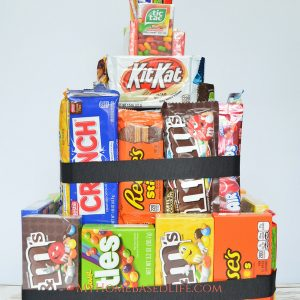 Who doesn't love candy? You can make this Candy Tower in place of a pinata. Everyone gets a chance to get candy and it's no leftovers. Don't worry busy moms, this is going to make your life a whole lot easier.#cakealternitive #birthday #candy #diy | Birthday Party Cake Ideas | Cake Ideas | Cake Alternatives | DIY | Candy |