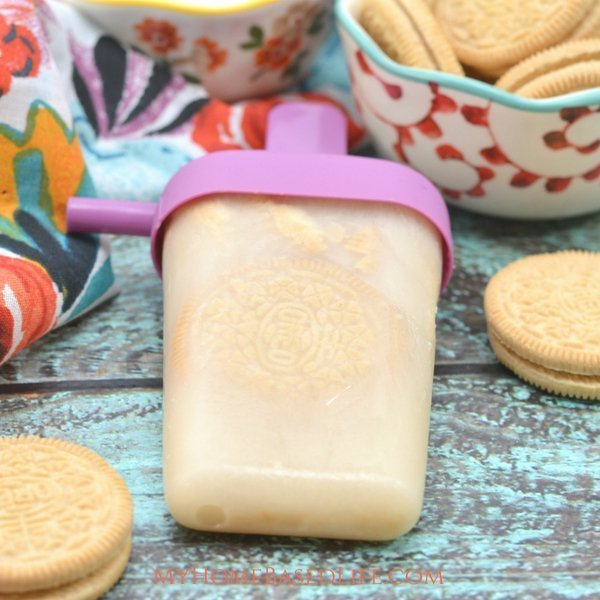 Summer is almost here and there isn't a better time for milk and cookies popsicles. A great combo of ice cream and popsicle. They're also super budget friendly! #popsicles #recipe #budgetfriendly #milkandcookies #summer   Summer Time Fun   Popsicle Recipe   Milk and Cookie Recipe   Dessert Recipe   Desserts  