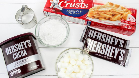 Mini smores pies are easy to make and perfect for summertime with little mess. It's like having a campfire year round with these amazing pies! #smores #pies #handpies #campingrecipe #myhomebasedlife | Pie Recipes | Hand Pie Recipes | Smores Recipes | Camping Recipes |