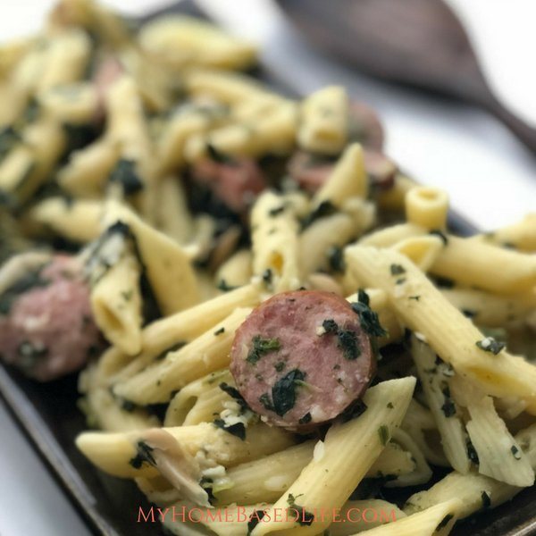 This One Pan Sausage Pasta recipe is the way to make your life easier with less mess. Mixing Sausage and Pasta with cajun seasonings, yum! #dinner #recipe #onepotmeal #easydinneridea #myhomebasedlife | Dinner Recipes | Pasta Recipes | Sausage Recipes | Easy Weeknight Meals | One Pot Meals | One Pan Dinners