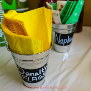 The easiest birthday party DIY ever. 3 Items for supplies and simple 2 steps to finished. Make these Football Penalty Flags for your Football Themed Party. #themedbirthday #footballparty #footballbirthdayparty #diy #penaltyflags #myhomebasedlife