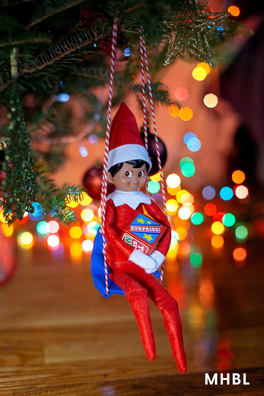 elf on the shelf idea - elf swinging in tree