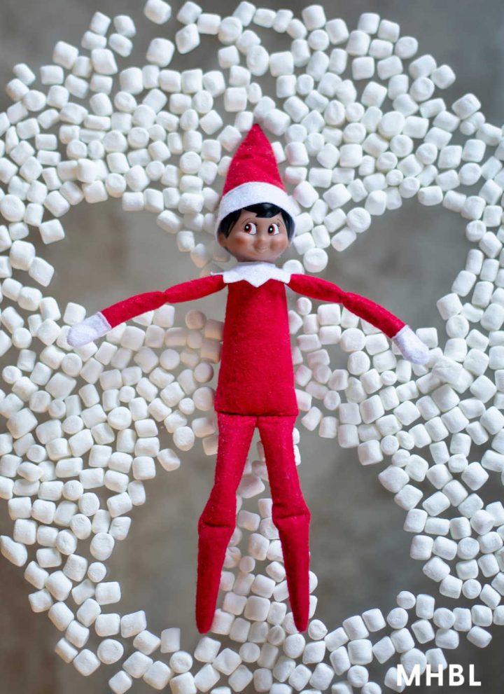 elf on the shelf ideas - elf making a marshmallow snow angel