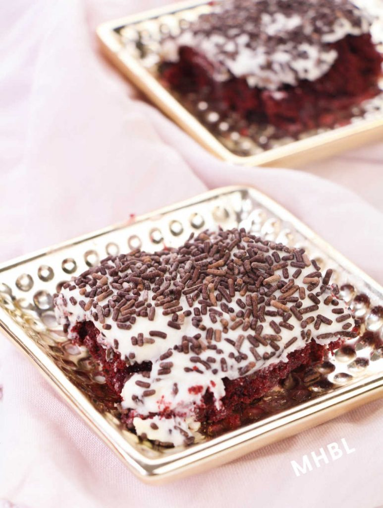 red velvet poke cake with rich cream cheese frosting