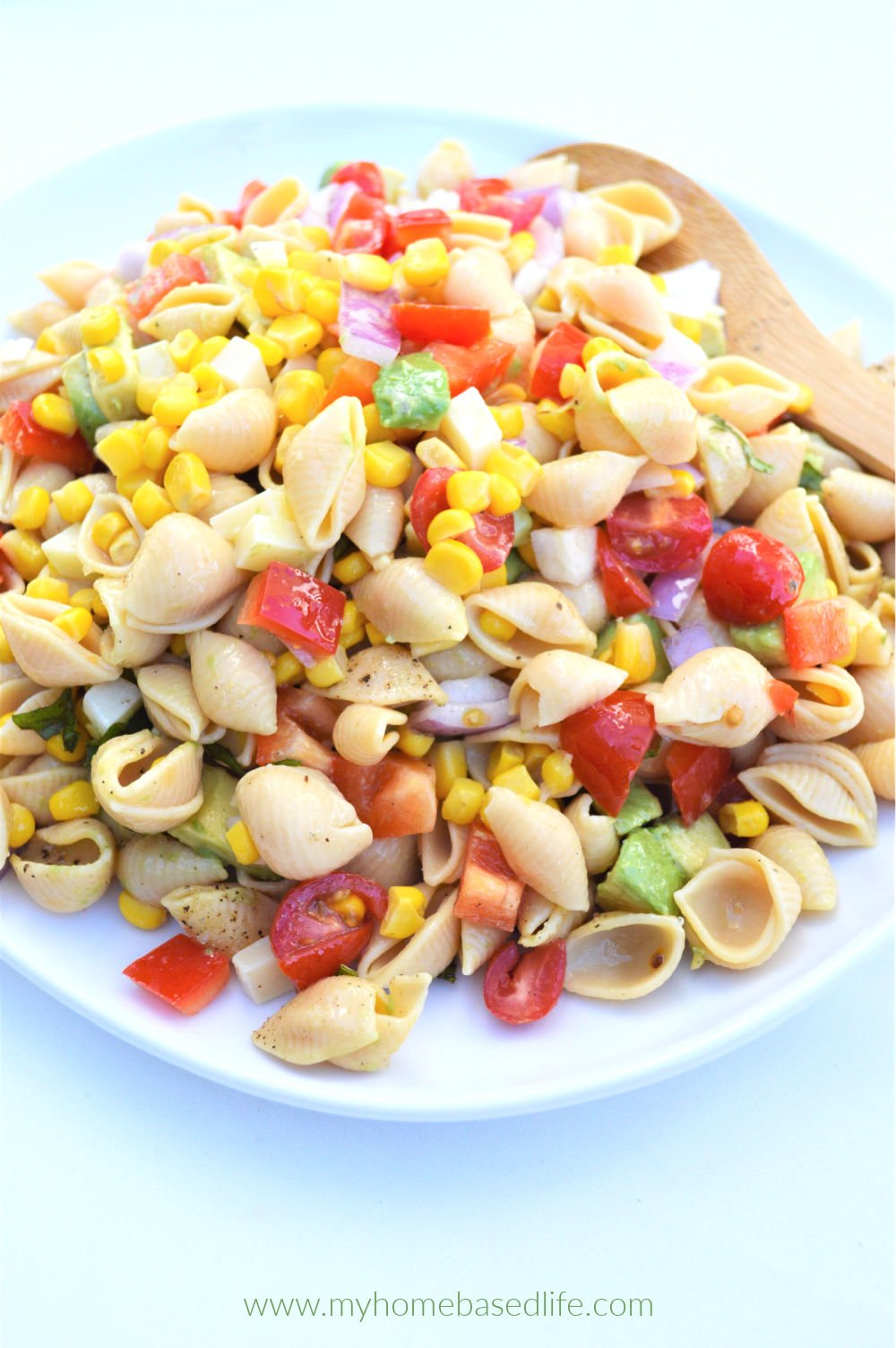 pasta salad with corn avocado and tomatoes